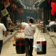 Stock Photo: Huang Long Xi ,China: Food Vendor with Shoulder Yoke