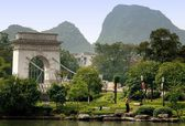 Guilin, China: Suspension Bridge and Parklands — Stock Photo