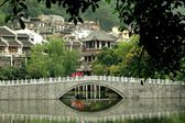 Yangshuo, China: Stone Bridge and Town Buildings — Stock Photo