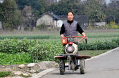 Pengzhou, China: Farmer Pushing Ground Tiller — Stock Photo
