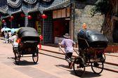 Luo Dai, China: Men Pulling Rickshaws — Stock Photo