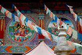 Jiu Zhai Gou,China: Tibetan Wall Paintings and Flags — Stock Photo