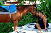Batu Ferringhi, Malaysia:  Man with his Horse — Stock Photo