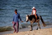 Batu Ferringhi, Malaysia: Guide Walking Girl on Horse — Stock Photo