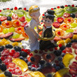 Stock Photo: Bride and groom on the cake