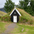 Stock Photo: Small church with grass roof