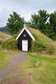 Small church with grass roof — Stock Photo