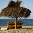 Sunchair and umbrella on the beach — Stock Photo