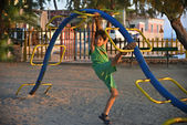 Boy playing at the playground — Stok fotoğraf