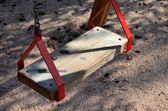 Red playground swing — Stock Photo