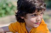 Happy boy outdoors close ups — Stock Photo