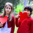Valentine day red hearts two kids — Stock Photo