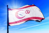 Northern Cyprus (Peace Symbol) flag waving on the wind — Stock Photo