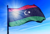 Libya flag waving on the wind — Stock Photo