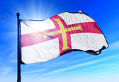 Guernsey flag waving on the wind — Stock Photo