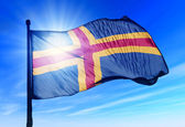 Aland Islands flag waving on the wind — Stock Photo