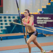 ������, ������: DONETSK UKRAINE FEB 09: Kristina Gadschiew pole vaulter runs with a pole in the hands