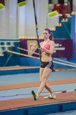 DONETSK,UKRAINE-FEB .09: Kristina Gadschiew - pole vaulter prepares to jump — Stock Photo