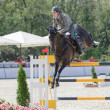 Italian rider Emanuele  Gaudiano at the 5th international show jumping tournament Donbass Tour 2013 CSI5 — Stock Photo