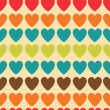 Stock Vector: Retro seamless pattern with colorful hearts