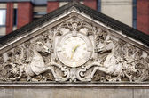 Clock with horses — Stockfoto