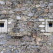 Stone wall with vents — Stock Photo