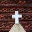 Stock Photo: White cross on the roof