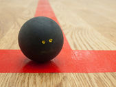 Squash ball on t-lin — Stock Photo