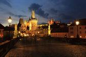 Prague St. Nicholas' Cathedral and Charles Bridge — Stock Photo