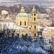 Snowy Prague St. Nicholas' Cathedral in the sunny Day, Czech Republic — Stock Photo