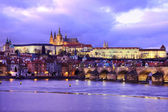 Prague gothic Castle with Charles Bridge after sunset, Czech Republic — Stock Photo