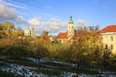 Autumn snowy Prague St. Nicholas' Cathedral — Stock Photo
