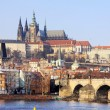 Romantic snowy Prague gothic Castle with the Charles Bridge in the sunny Day,  Czech Republic — Stockfoto