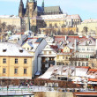 Snowy Prague's gothic Castle above River Vltava — Stockfoto #32278025