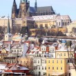 Stockfoto: Snowy Prague's gothic Castle above River Vltava