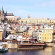 Stock Photo: Snowy Prague's gothic Castle above River Vltava