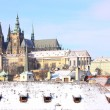 Stock Photo: Romantic Snowy Prague gothic Castle above River Vltava, Czech Republic