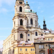 Romantic Snowy Prague St. Nicholas' Cathedral in the sunny Day, Czech Republic — Stock Photo