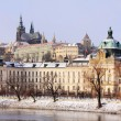 Snowy Prague's gothic Castle above River Vltava — Stock Photo #32289663
