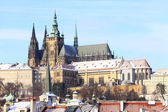 Romantic Snowy Prague gothic Castle above the River Vltava in the sunny Day, Czech Republic — Stock Photo
