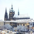 Stock Photo: Snow in Prague, gothic Castle above River Vltava