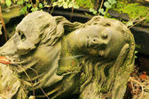 The stone Girl on Tomb from the old Prague Cemetery, Czech Republic — Stockfoto