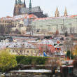 Stock Photo: First Snow in Prague, gothic Castle above River Vltava