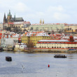 First Snow in Prague, gothic Castle above River Vltava — Stockfoto #36936957