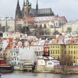 First Snow in Prague, gothic Castle above River Vltava — стоковое фото #36937079