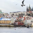 First Snow in Prague, gothic Castle above River Vltava — стоковое фото #36937237