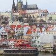 First Snow in Prague, gothic Castle above River Vltava — стоковое фото #36937403
