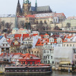 Stock fotografie: First Snow in Prague, gothic Castle above River Vltava