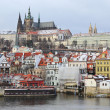 Stockfoto: First Snow in Prague, gothic Castle above River Vltava