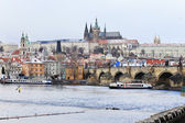 First Snow in Prague, snowy gothic Castle with the Charles Bridge, Czech Republic — Stock Photo
